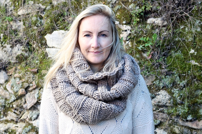 woman wearing a huge knitted infinity scarf
