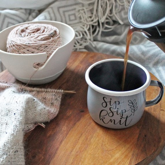 knitters coffee mug and yarn bowl with knitting