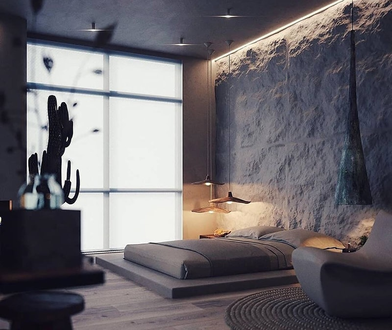 Eco conscious design in a bedroom with exposed rock surface walls