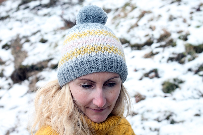 woman wearing a fair isle knit beanie hat