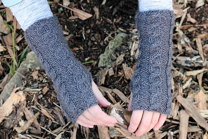 Grey cable knitted fingerless mittens