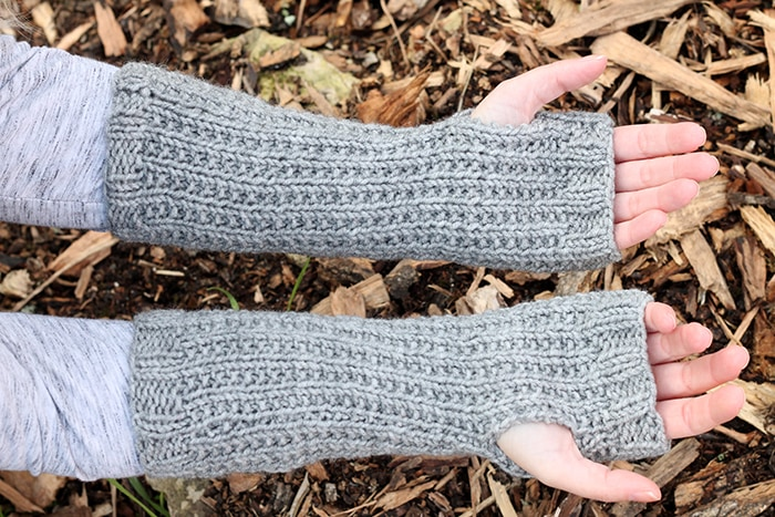 Underside view of fingerless mittens showing thumb holes