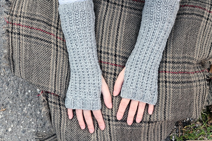 broken rib stitch fingerless gloves on a plaid blanket
