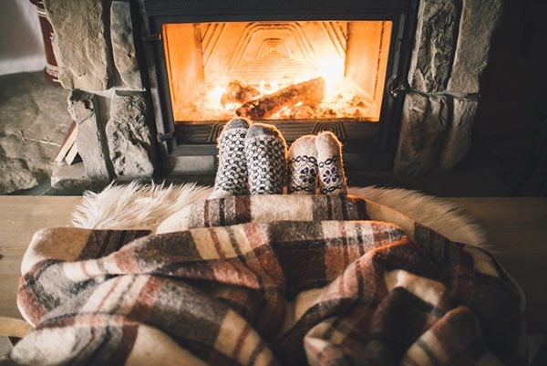 cosy socks beside fireplace and blankets