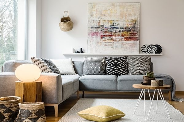 cozy living room interior with baskets and wall art