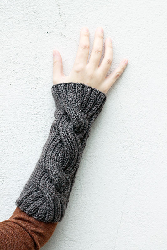 Cable wrist warmers in brown yarn