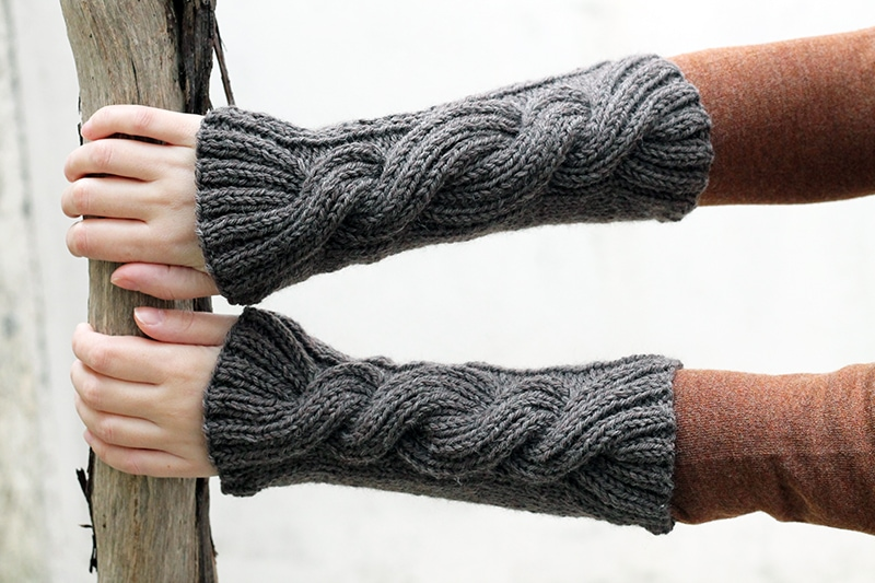 Claire's hand knitted wrist warmers with large cable design