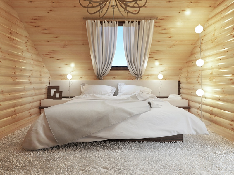 Cozy log cabin bedroom interior