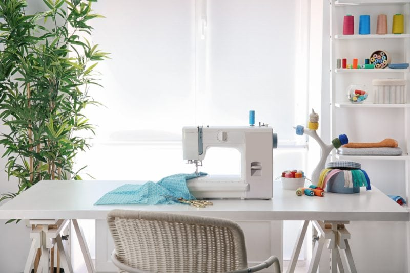 Craft room table with sewing machine