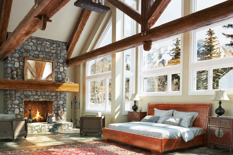 Log cabin bedroom with open fireplace