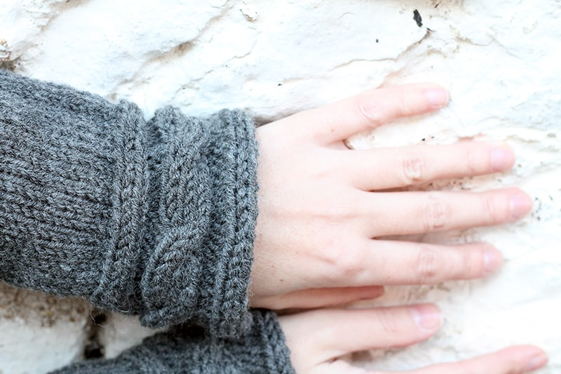 close up of knitted cable cuffs