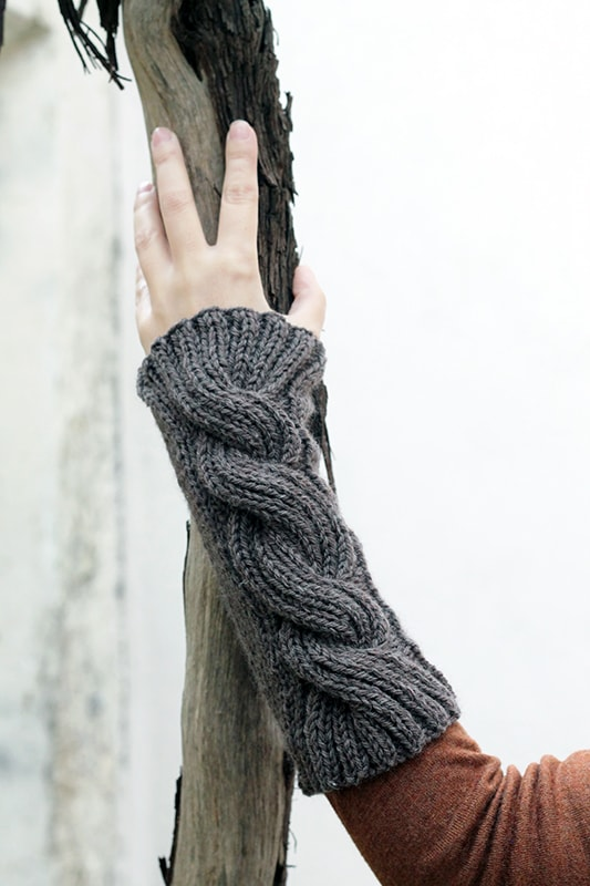 large twisted cable knitted arm warmers