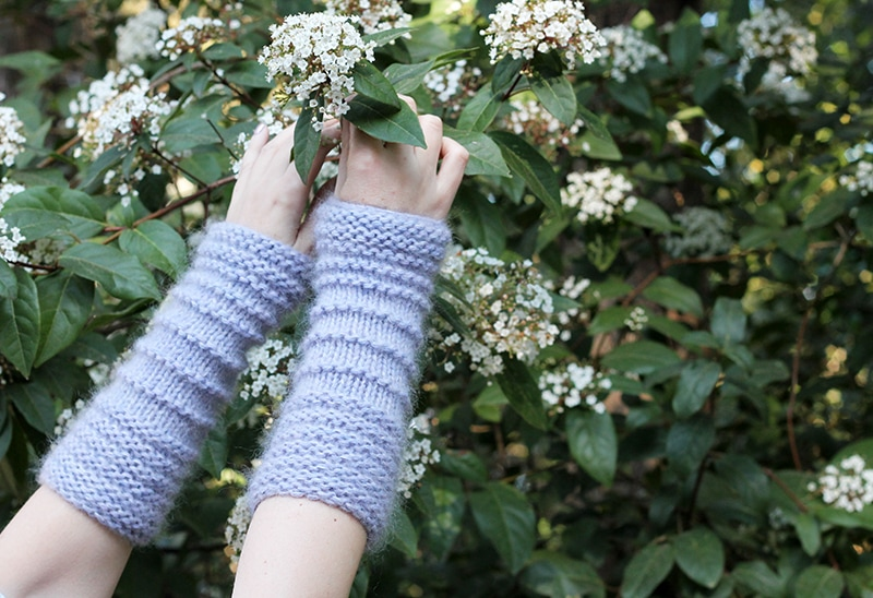 woman wearing arm warmers and picking flowers