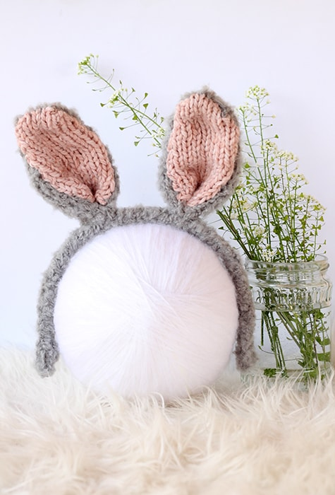 knitted bunny ears headbad in grey and pink fluffy yarn