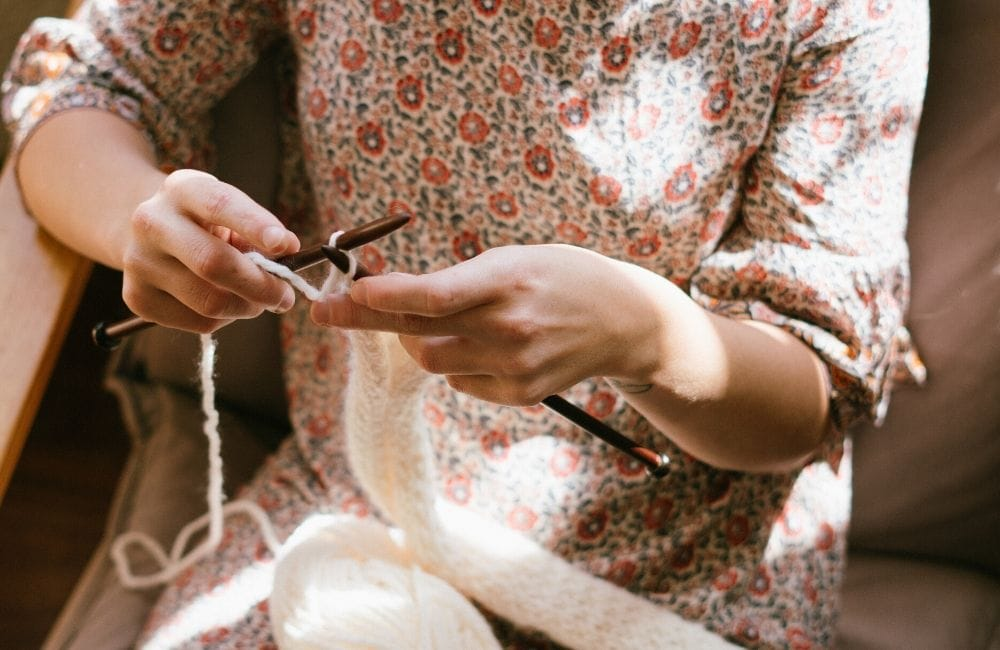 woman knitting with two needles