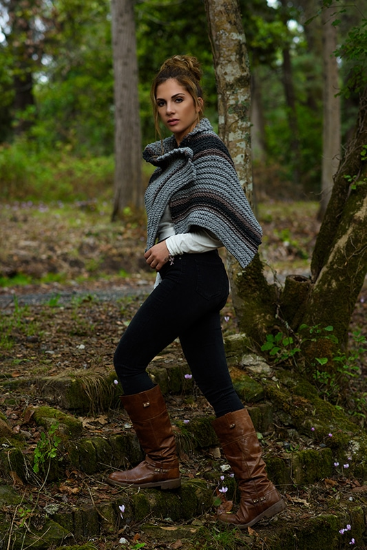 Outlander knitwear including a striped knitted cape