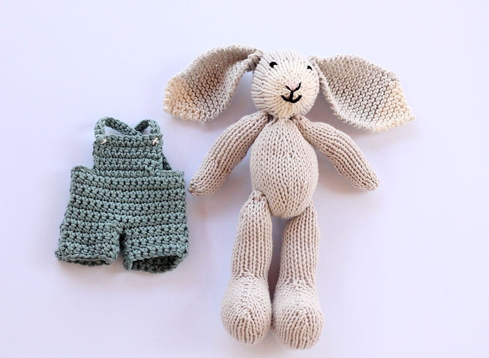 knited bunny toy with clothes