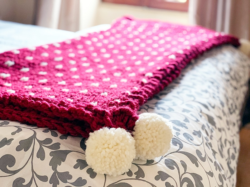 Christmas blanket with pom poms