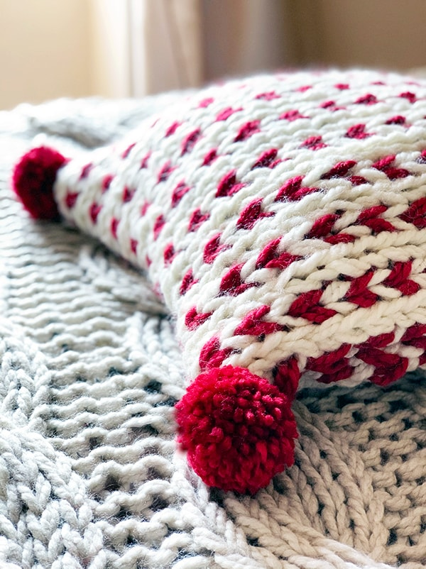 chunky knit pillow with pom poms