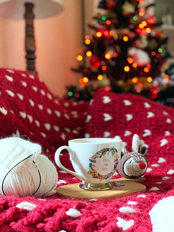 Christmas throw blanket on the sofa