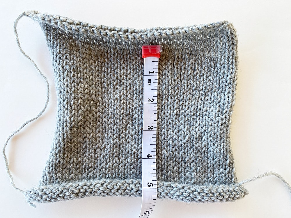 measuring up and down a gauge swatch in knitting