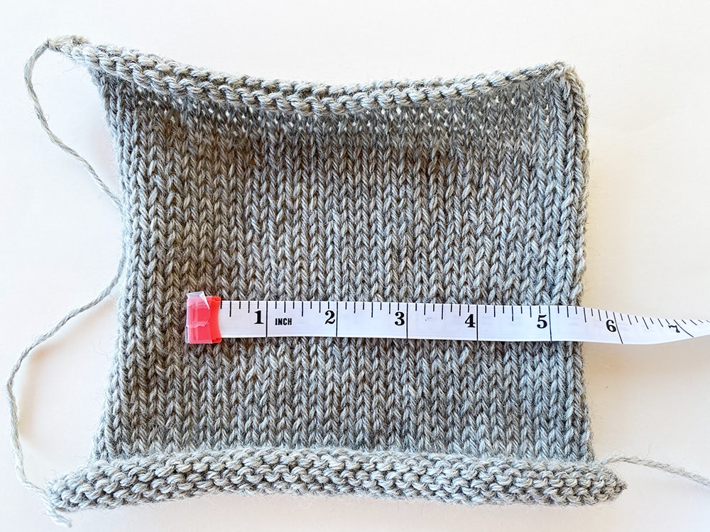 measuring a gauge swatch in knitting