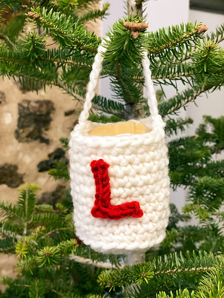crochet bag with a crochet letter on it