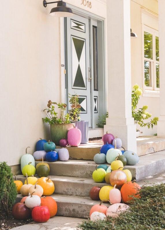Rainbow pumpkins on a porch