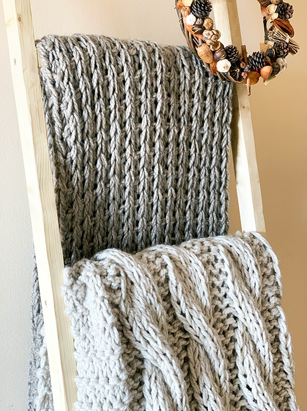 knitted blankets on a blnaket ladder