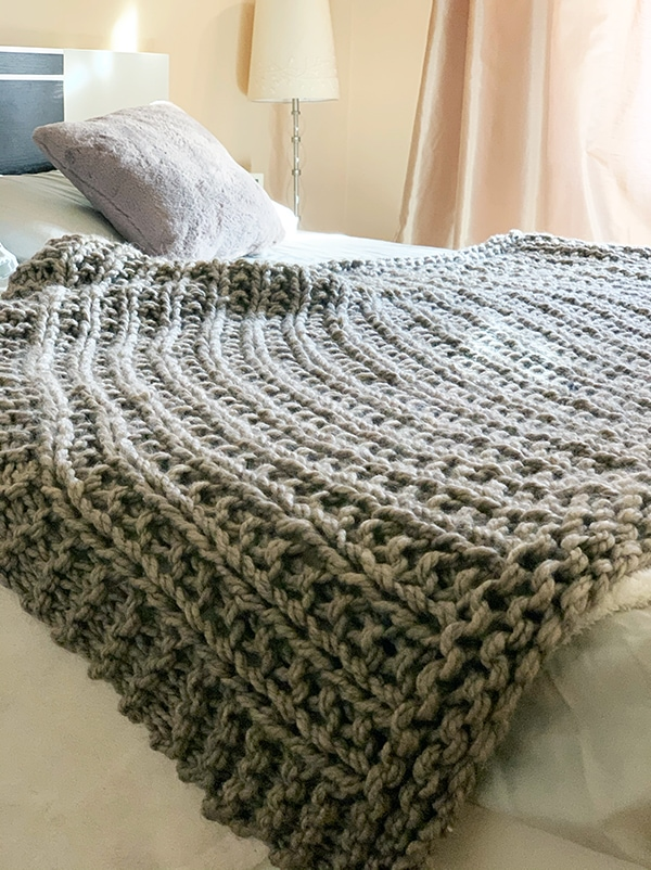 chunky blanket on bed