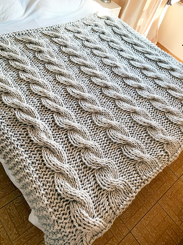 chunky knit blanket on a large bed