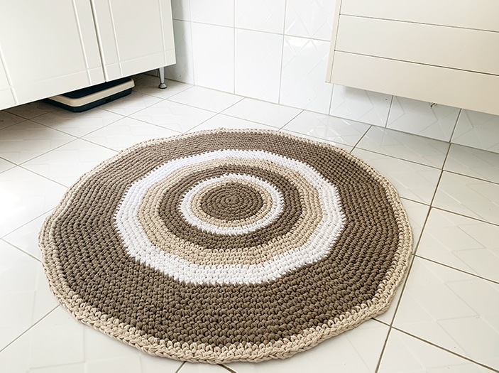 crochet circle rug on a bathroom tiled floor