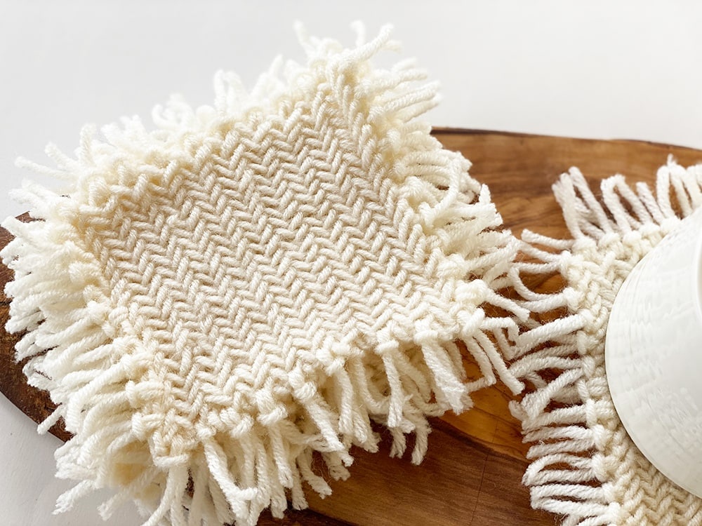 knitted coaster with fringe