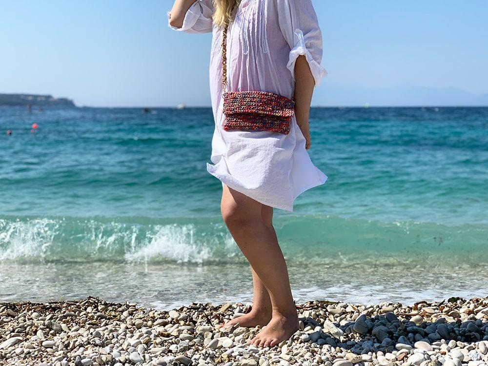woman wearing a crochet bag at the beach