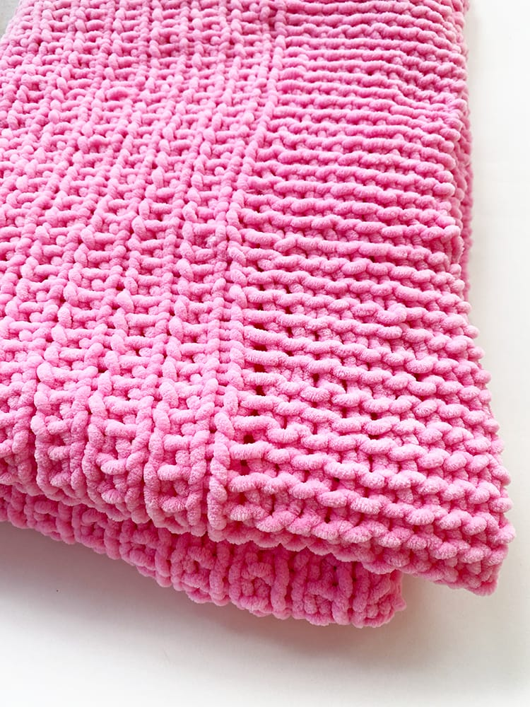 pink knit baby balnket in chenille yarn