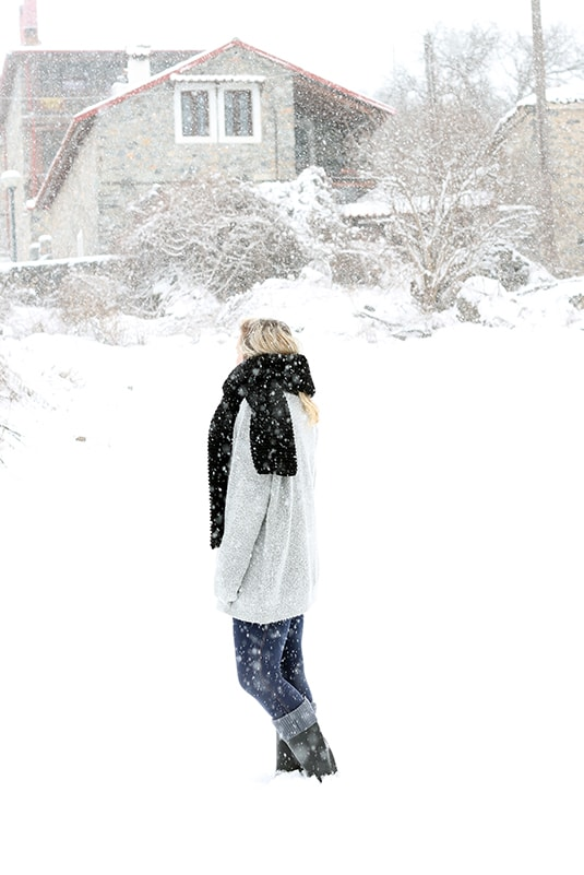 woman wearing a black knit scarf in the snow