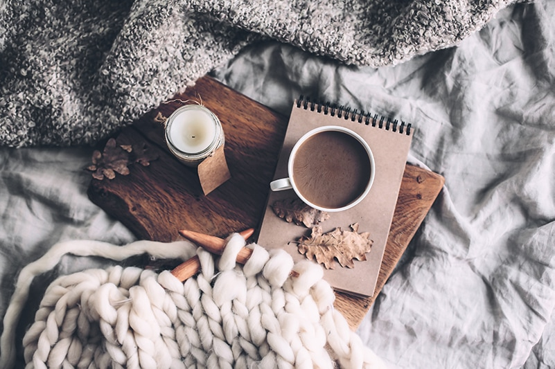 knitting on circular needles, hot chocolate and a notebook flatlay