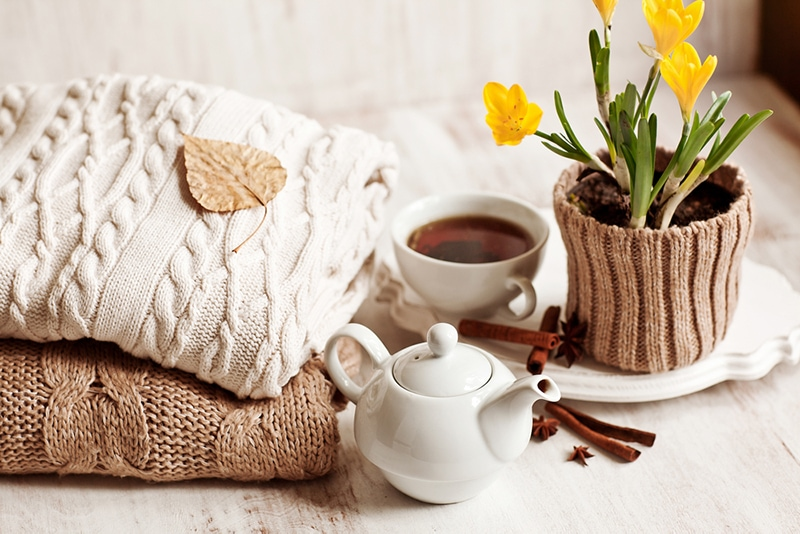 fall sweaters and a pot of tea