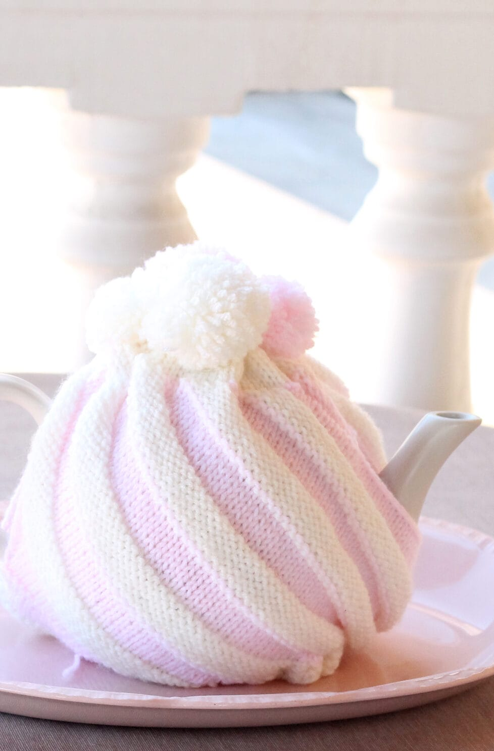 pink and white striped knitted tea cosy