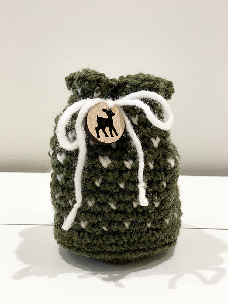 Crochet drawstring bag in white and green yarn