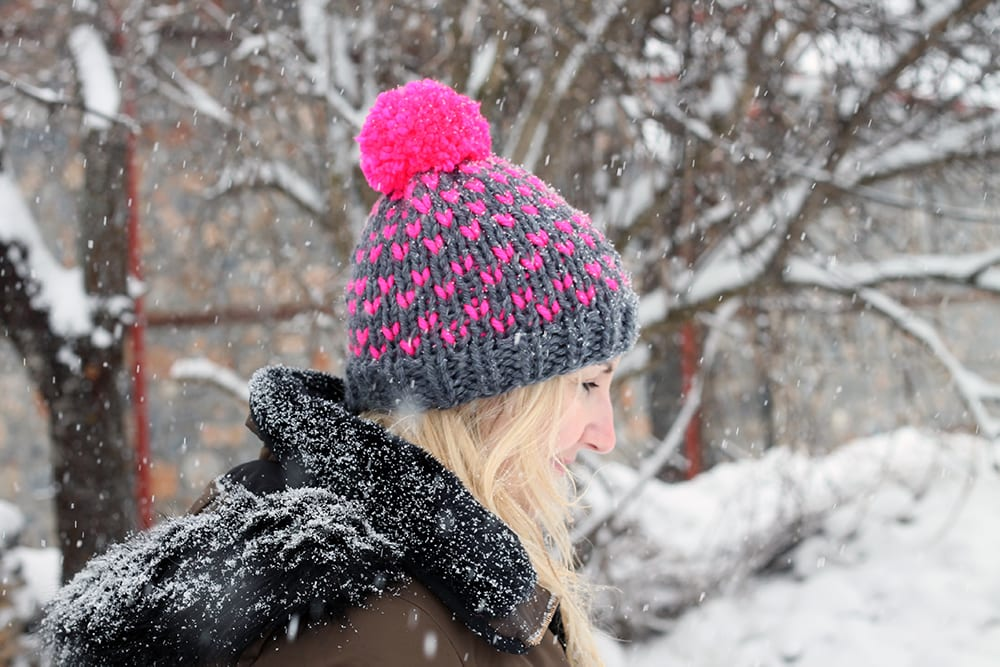 pink and grey knitted beanie hat