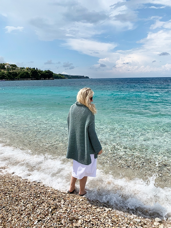 woman at the beach wearing a baggy sweater