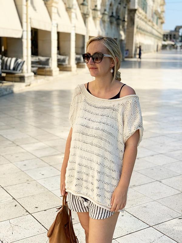 woman wearing a drop stitch knit top