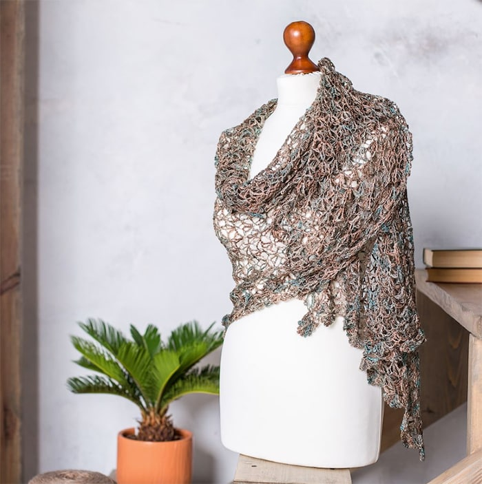 mannequin with lace weight knitted shawl wrapped around the shoulders