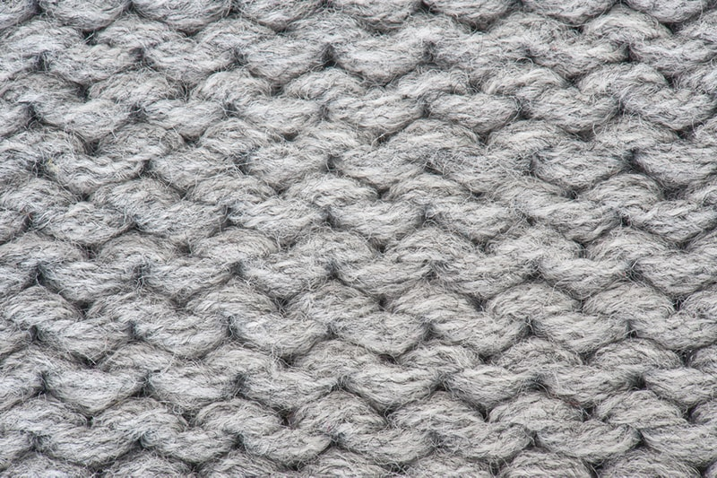 the purl stitch knit in grey yarn