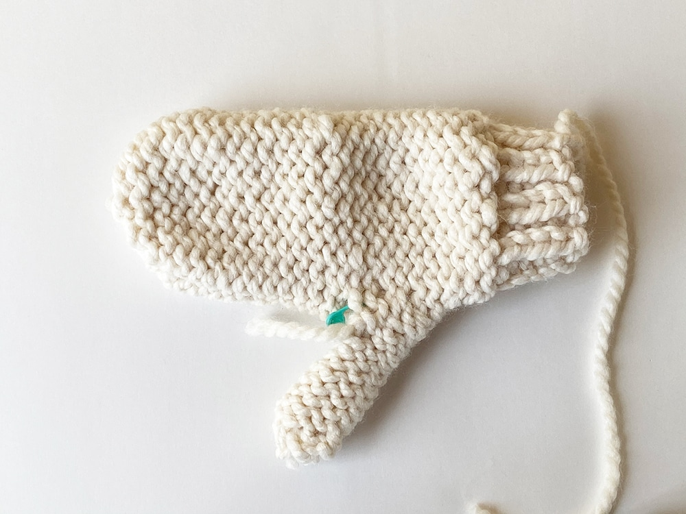 weaving in the ends of the finished mitten