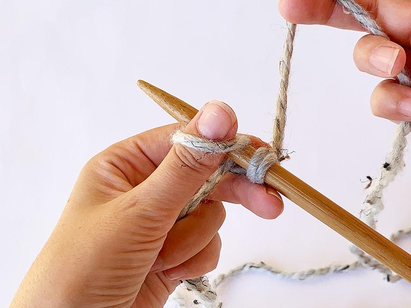 wrap the yarn around the thumb