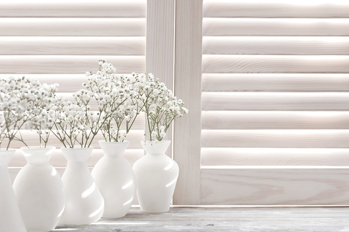 white wooden eco-friendly window shutters