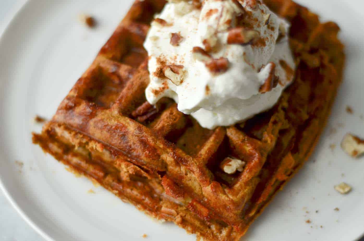 Pumpkin pie chaffle with whipped cream and pecans on top