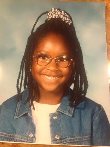 Young girl in glasses.